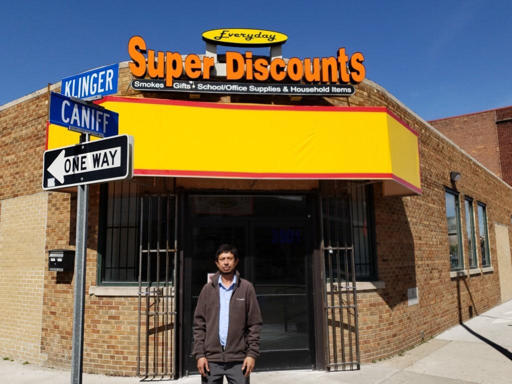 Razaul Karim in front of his store, Super Discounts